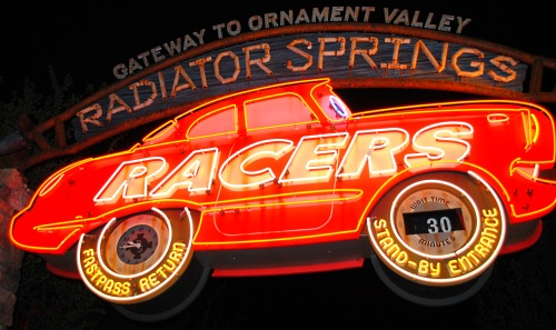 Radiator Springs Racers sign at night