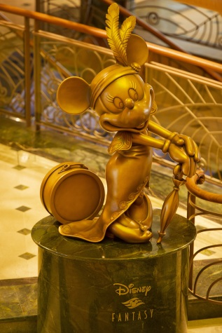 Minnie Mouse in bronze in Disney Fantasy atrium lobby