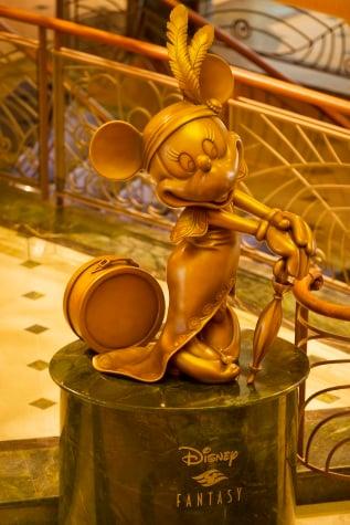 Minnie Mouse in bronze in Disney Fantasy atrium lobby