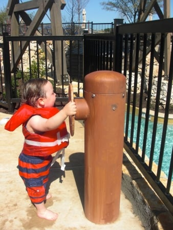 My son spinning a pump to spray water onto the lazy river at JW Marriott San Antonio (Photo credit: Colleen Lanin)