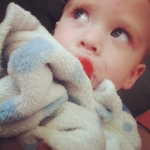 Baby with favorite blanket and pacifier