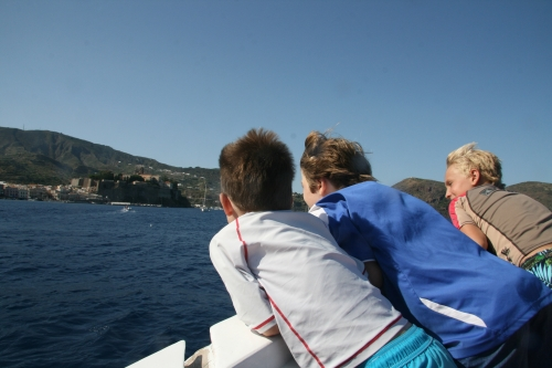 With the kids in Sicily, enjoying our private boat tour of Vulcano