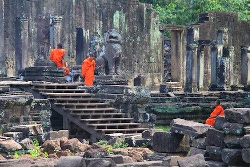 Monks at the ruins of Angkor Thom in Cambodia