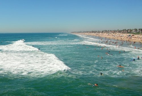 Surfers Catching Waves Huntington Beach