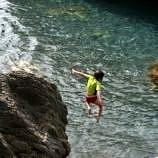 My 6-year-old daughter enjoying the vertical pleasures of Grotte Beach