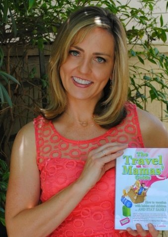 The Travel Mama Colleen Lanin holding The Travel Mamas' Guide