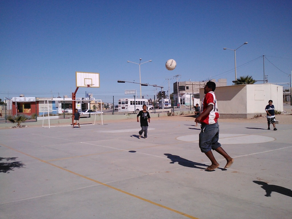 Locals playing soccer in Los Cabos, Mexico