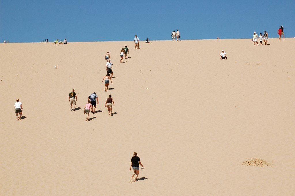 Climbing the Sleeping Bear Dunes is fun for all ages (Photo courtesy of Traverse City Convention & Visitors Bureau)