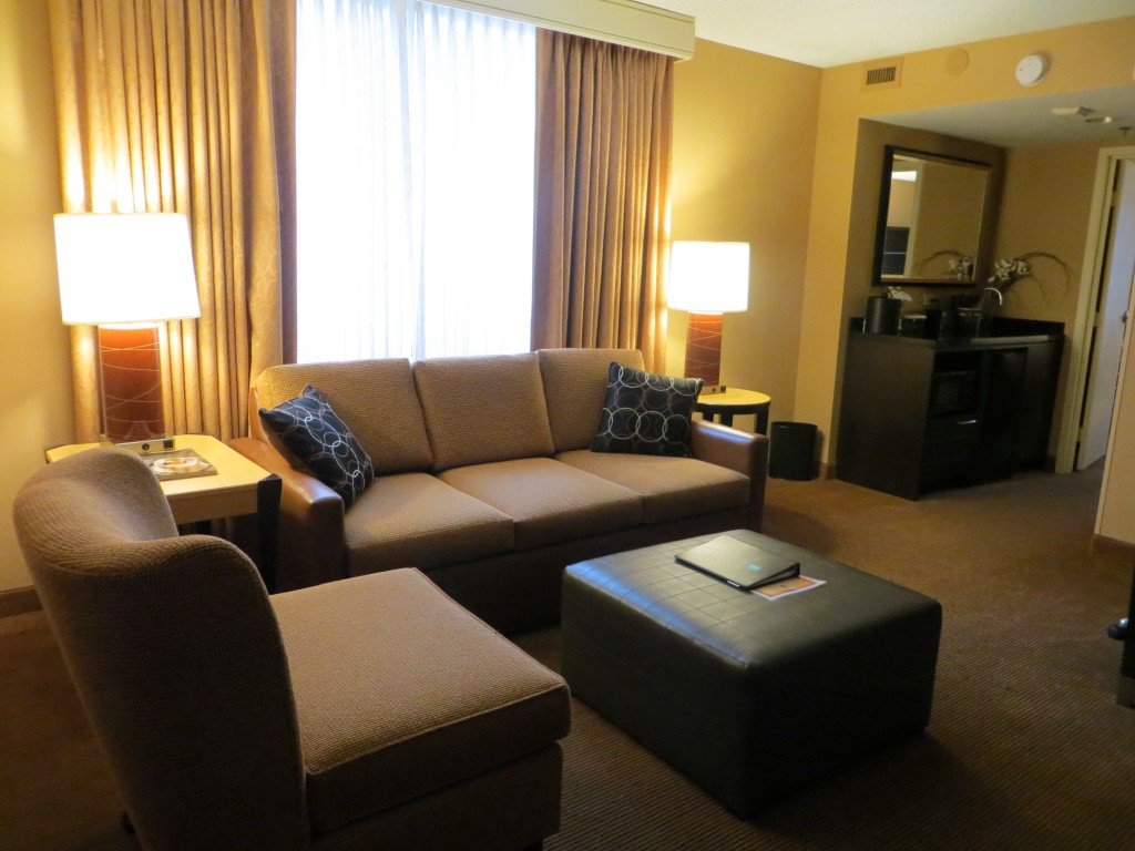 The seating area of a living room of a suite at Embassy Suites Chicago Downtown