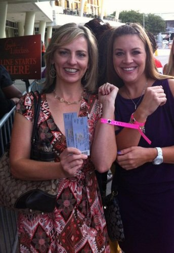 Showing off our pink VIP wristbands at Oprah's Life Class