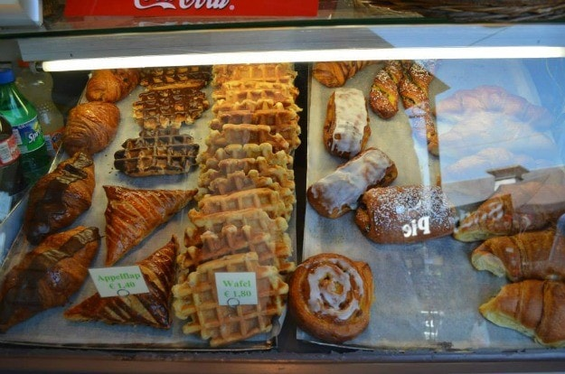 A pastry case filled with waffles and other goodies in Gent, Belgium