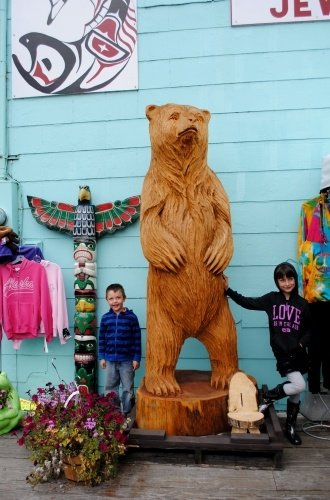 Kids with a bear totem in Ketchikan, Alaska