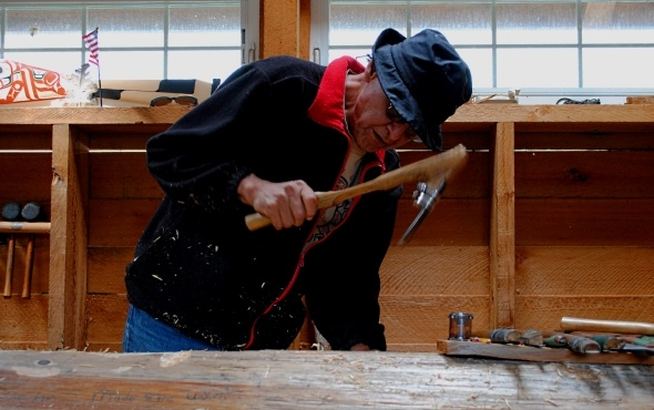 A totem carving demonstration in the Tongass National Forest near Ketchikan, Alaska