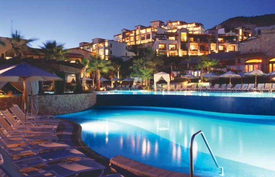 Nighttime view of one of Pueblo Bonito Sunset Beach Resort & Spa's seven pools