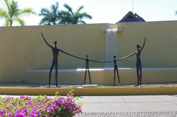 Sculpture of family holding hands at Four Seasons Punta Mita