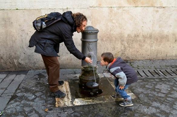 Nancy Aiello Tour guide at a Roman fountain