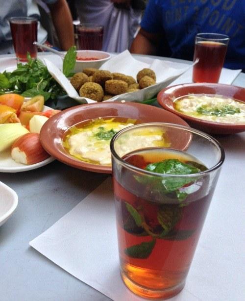 Jordanian lunch of hummus, falafel, baba ganouj and addictive mint tea (Photo credit: Claudia Laroye)