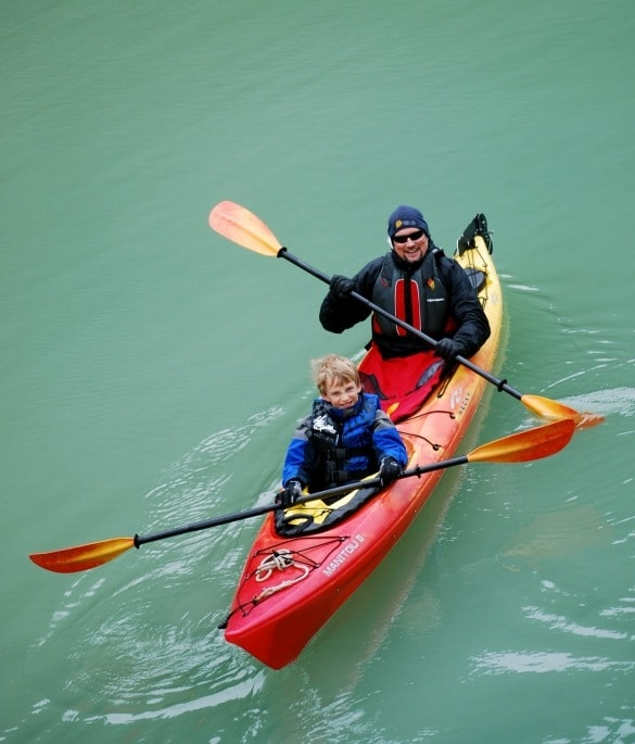 Erin's son and husband exploring Alaska by water