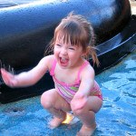 Playing in a Disney Cruise Line splash pad for non-potty-trained kids