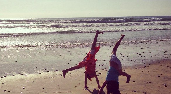 Bailey and Karissa turning cartwheels on the beach in San Diego not long before our move (Photo credit: Colleen Lanin0