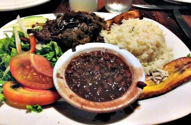 Traditional Costa Rican specialties: beef, fried plantain, gallo pinto (Photo credit: Claudia Laroye)