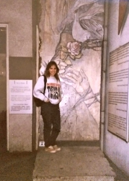 Standing in front of a piece of the Berlin Wall in 1995, just six years after it fell