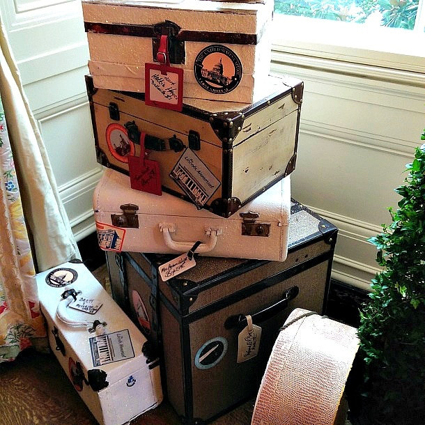 Glittering vintage luggage  encourages wander lust in the White House's State Dining Room (Photo credit: Colleen Lanin)