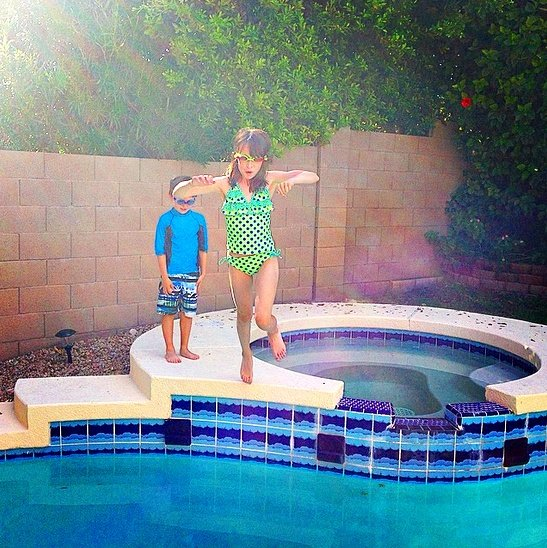 My kids jumping into our backyard pool in Scottsdale, Arizona (Photo credit: Colleen Lanin)