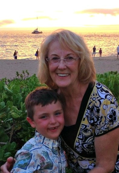 Grandson and grandma posing in front of yet another beautiful sunset at Sheraton Maui