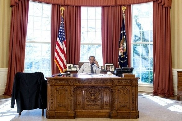 President Barack Obama at the Resolute Desk in the Oval Office (Photo credit: The White House)