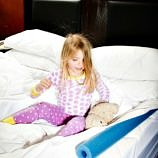 A pool noodle can act as a bed bumper on the fly - Embassy Suites #PrettyGreat Family Travel Hacks