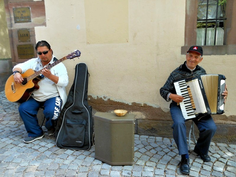 Friendly street performers playing music in Strasbourg, France