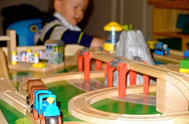 son loves train travel Europe child