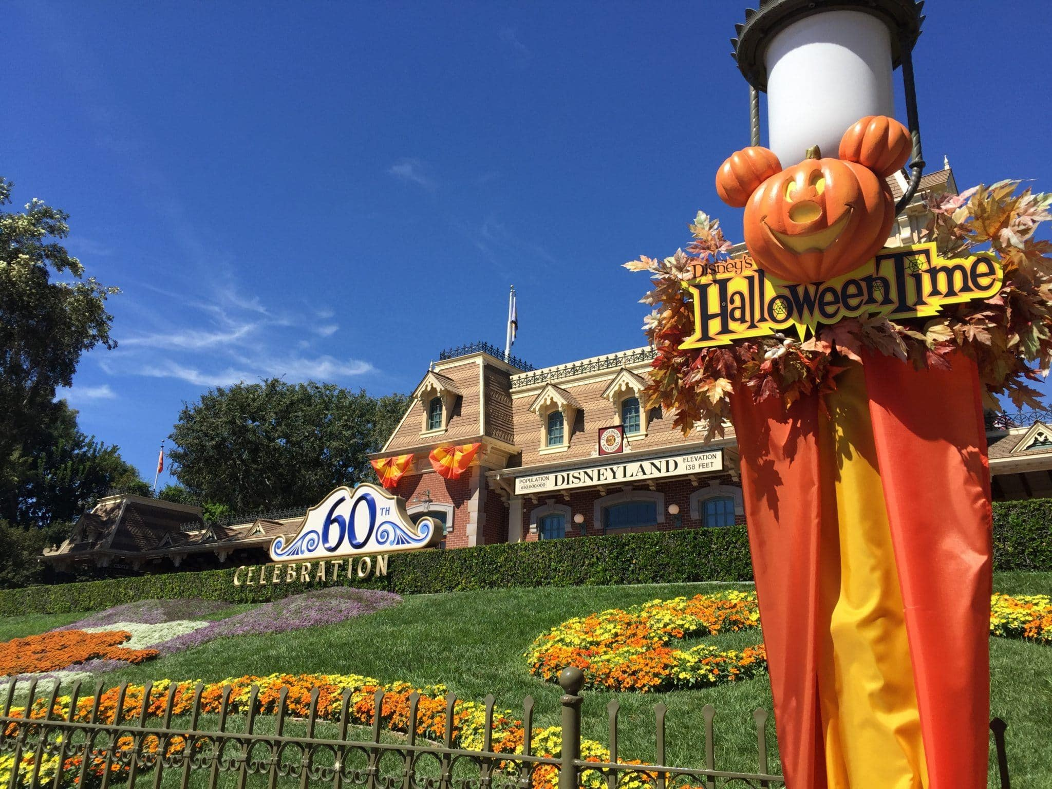 Diamond Anniversary and Halloween Time decorations at the entry to Disneyland