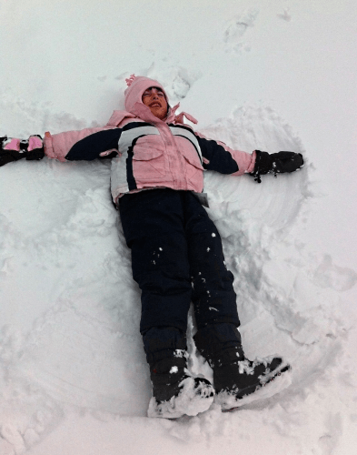 My daughter making a joyous snow angel
