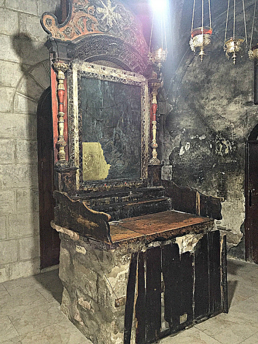 A small, curved stairway to the crypt that contains the bones of Jesus can be found in this unmarked chapel, which was damaged by fire, at the Church of the Holy Sepulchre
