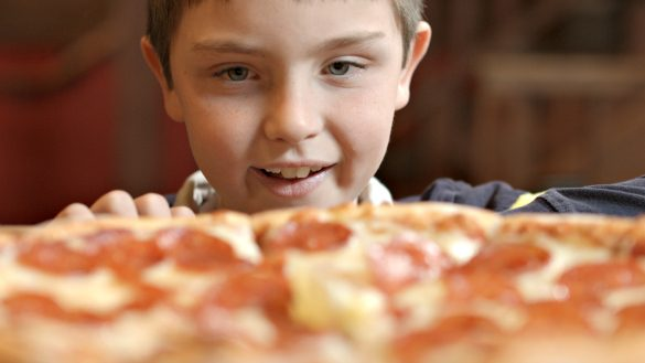 My son drooling over a Red Banjo pizza in Park City