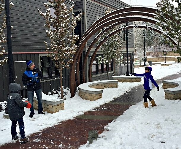 A family snowball fight along Park City's Main Street ~ What to Do in Park City Beyond the Slopes