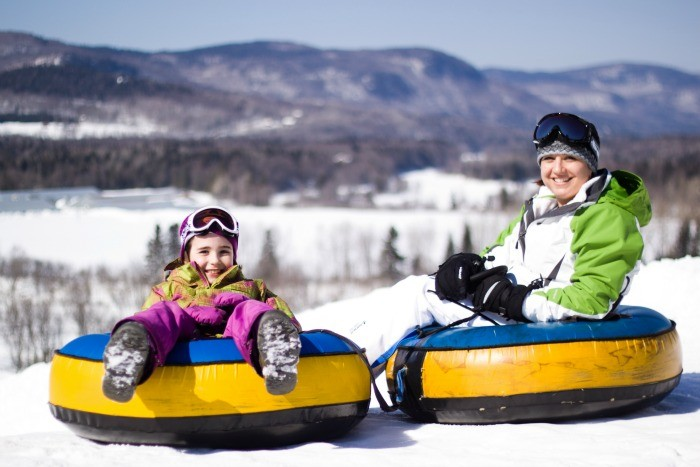 Youcan reach speeds over 40 miles per houron some tubing runs at Valcartier Village in Quebec ~ Quebec City Winter Fun for Families