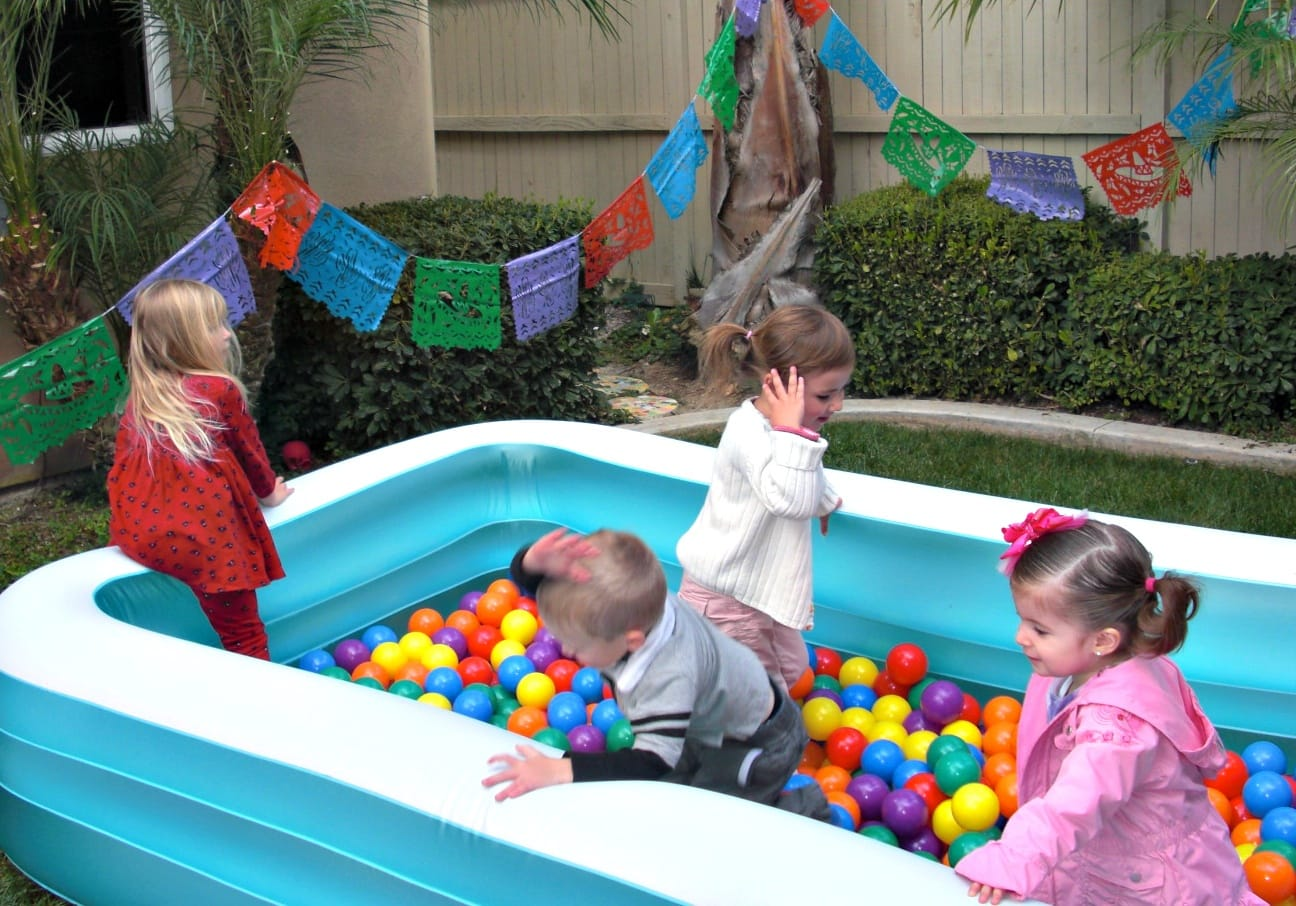 Fill your play pool with plastic balls to make your own ball pit ~ 10 Fun in the Sun Summer Boredom Busters