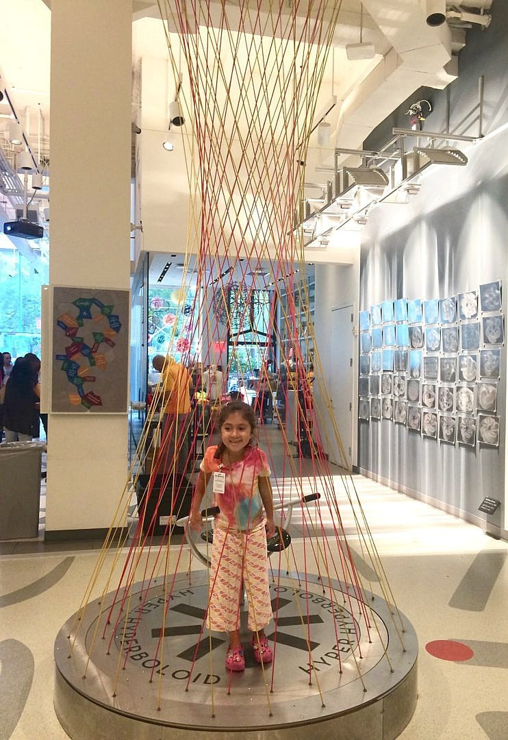 The Hyper Hyperboloid chair is a favorite with kids and grown ups alike at MoMath Museum in New York City