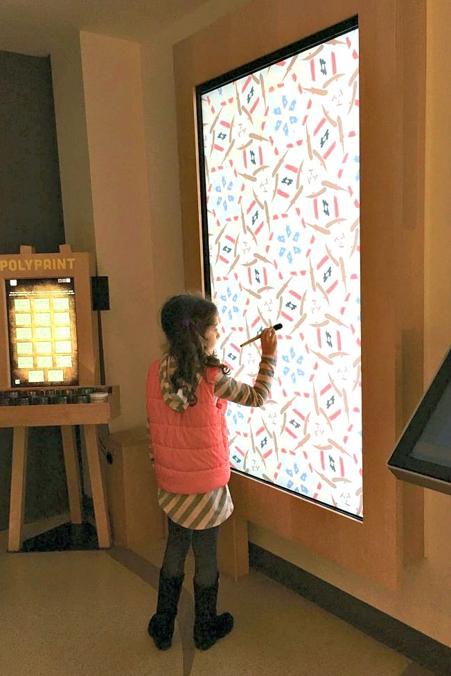 "The Polypaint exhibit lets kids ""paint"" on a digital canvas at MoMath Museum in New York City"