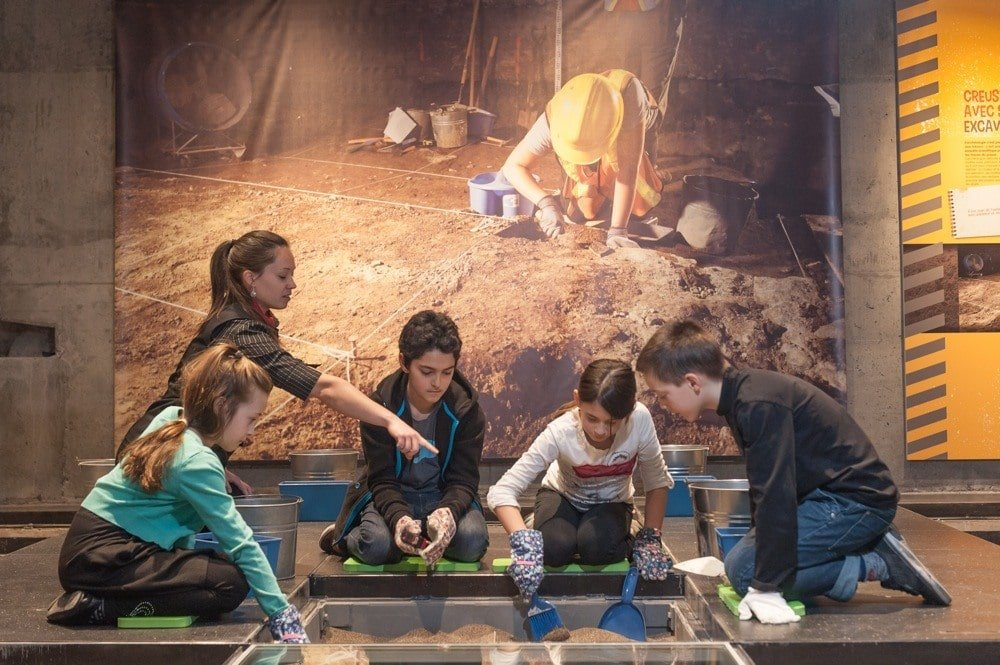 An archeological workshop with kids at Montreal Museum of Archeology and History