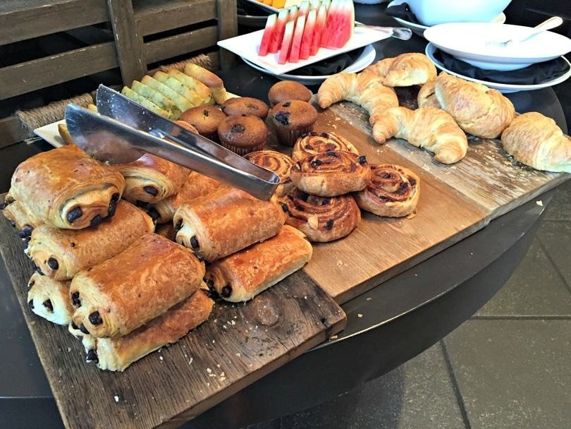 A tempting selection of breakfast pastries at Le Place d'Armes Hotel.