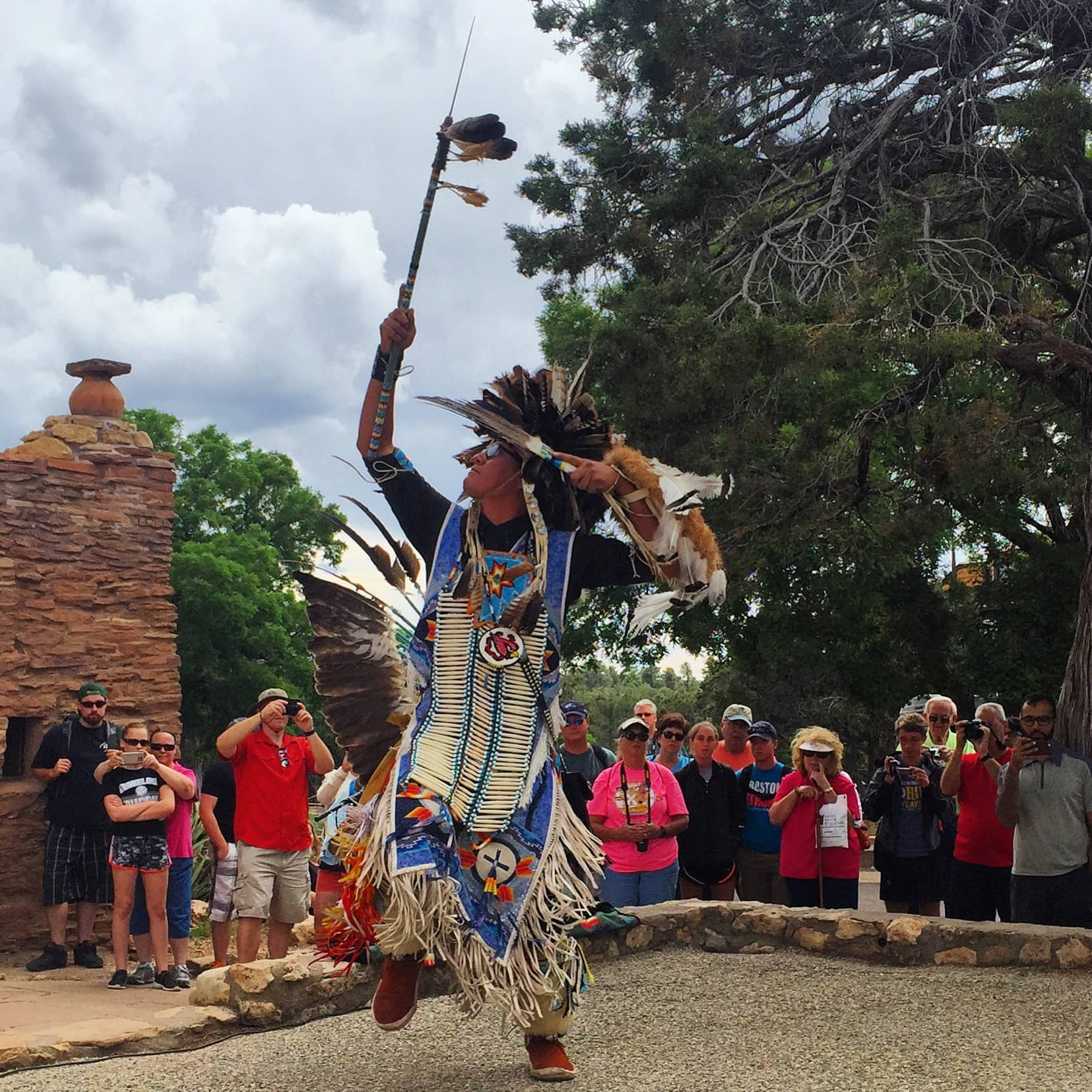 A Navajo troupe member performing a traditional dance near Hopi House at the South Rim