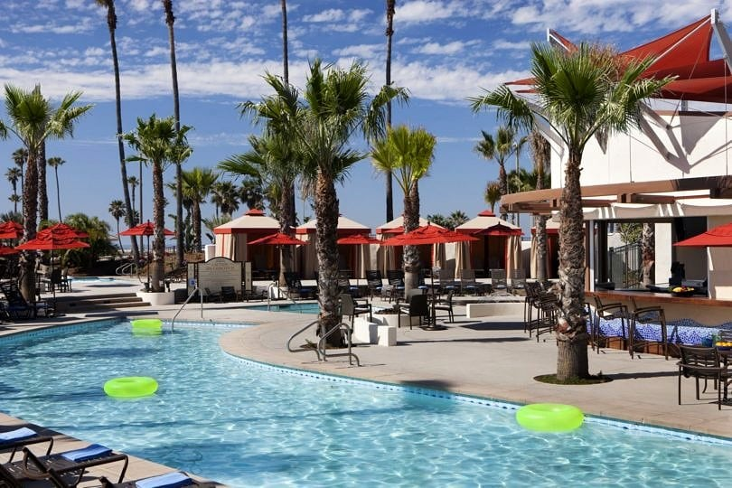 The palm-lined pool at Hyatt Regency Huntington Beach Resort & Spa ~ Best Hotel Pools for Kids in the USA