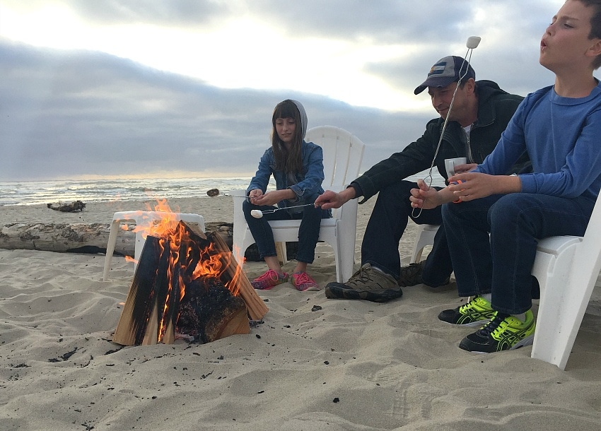 Roasting marshmallows for s'mores at Cannon Beach ~ 10 Things You Must Do in Oregon's Cannon Beach with Kids