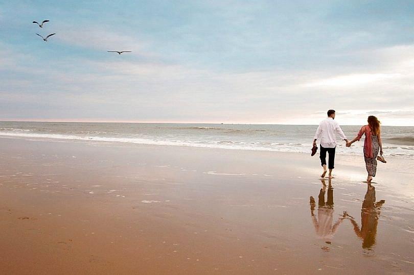 Walking hand-in-hand on Resort Beach ~ Virginia Beach Romantic Getaway