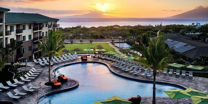 View of Residence Inn Maui's pool with the ocean and Lanai in the distance