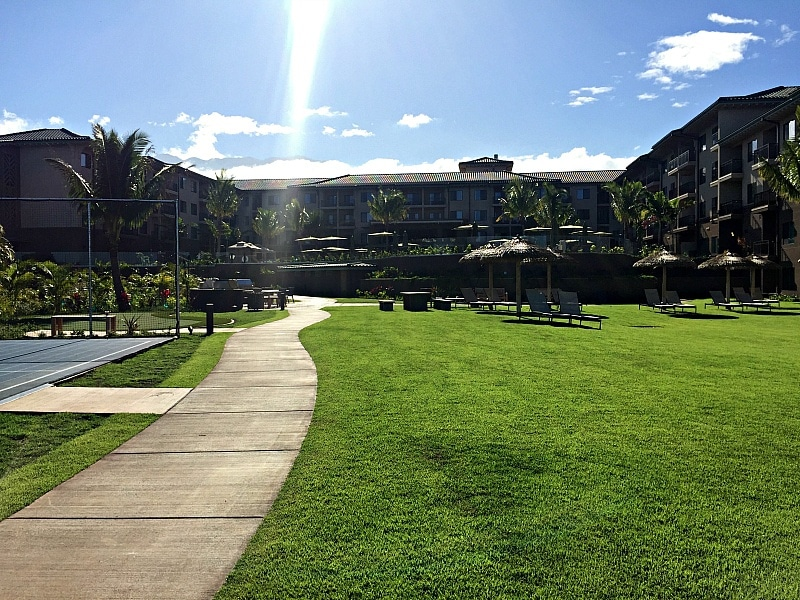 View of Residence Inn Maui lawn and sport court